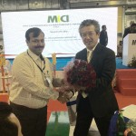 Presenting bouquet to MD, MKCI on Inaugural Ceremony